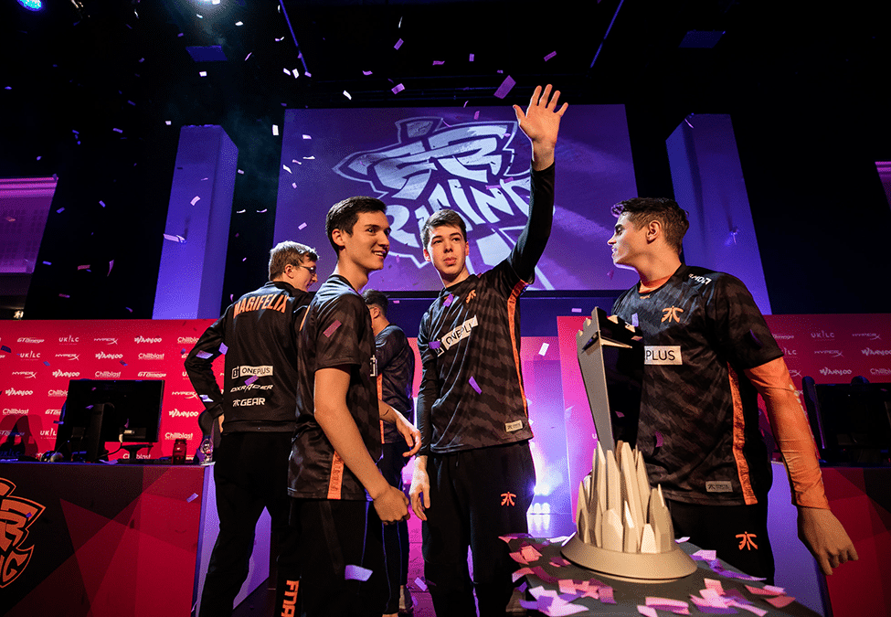 Picture showing a professional team, cheering to their fans after a victory.
