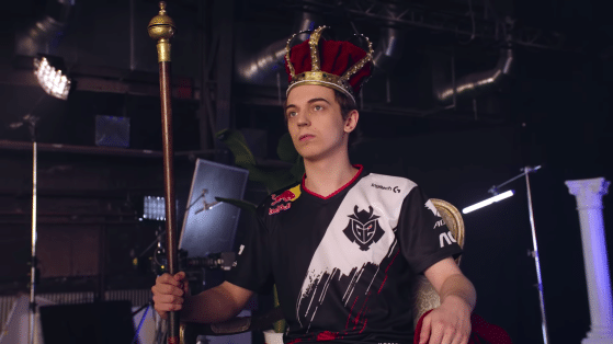 G2 caps wearing a crown and holding a scepter