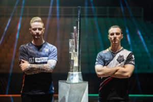 Rekkles and Perkz standing beside the LEC Trophy