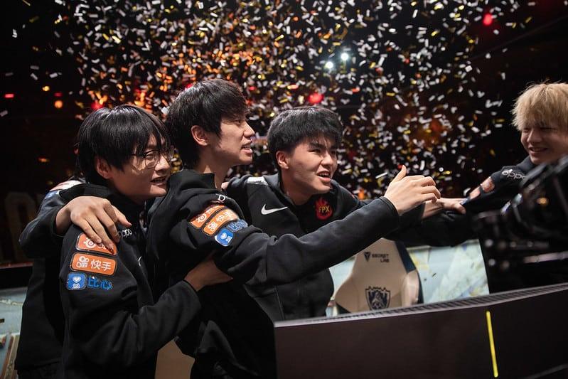 FunPlus Phoenix hugging each other after winning Worlds